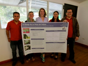 Last spring, with my research poster & co-workers