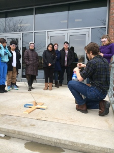 Alex sets up the bottle rocket, which we launched on the steps of the Olin-Rice science building