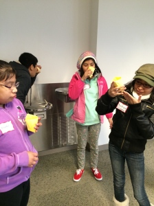 Students test out their origami cups, which they built only by making observations on a pre-made cup.